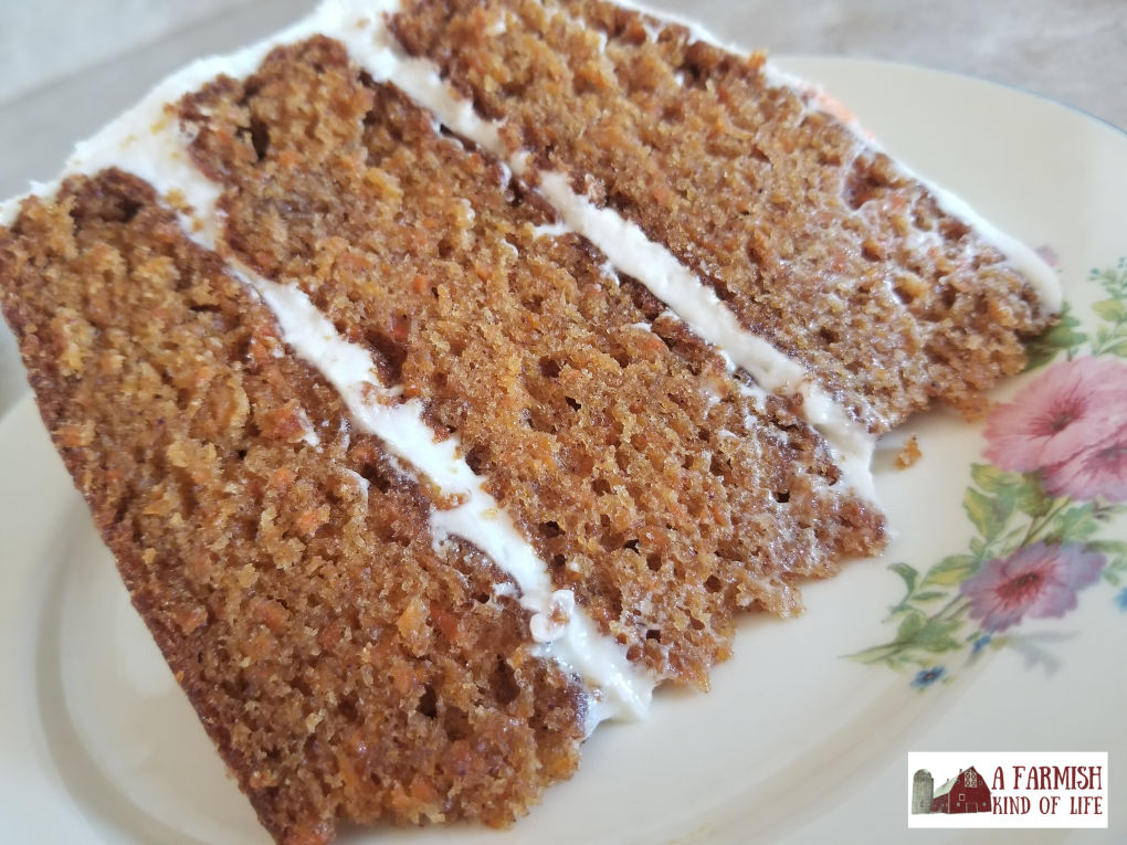 Fancy up your farmhouse dinner with this delicious triple layer carrot cake topped with the best darn cream cheese frosting you will ever taste.