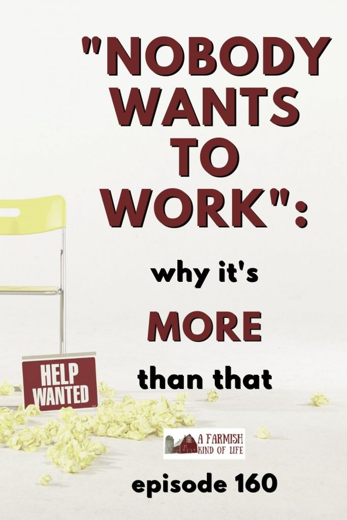 A help wanted sign sitting against an empty chair.