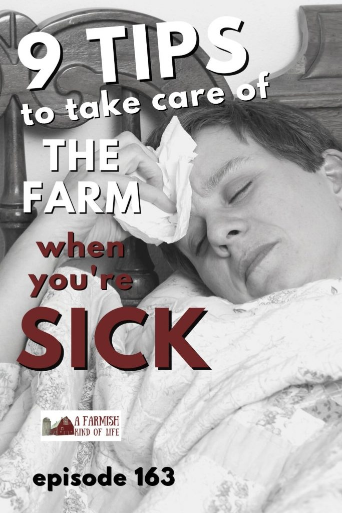 Sick woman laying in bed with her eyes closed, holding a tissue to her forehead